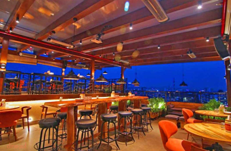 A view of open terrace restaurant of Jaipur. It is a perfect restaurant, with chairs, sofa, small tables and decorative lights. Small chair, sofa chairs and designed lighting
