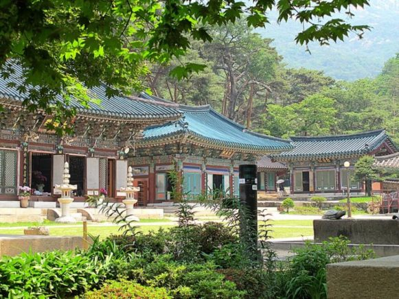 A picturesque Korean temple surrounded with greenery